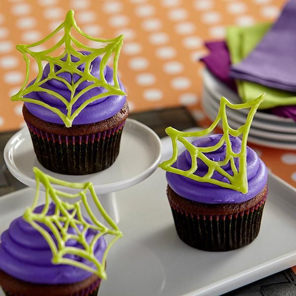 Learn how to make these easy spider web cupcake toppings using Candy - wilton halloween cupcake decorations