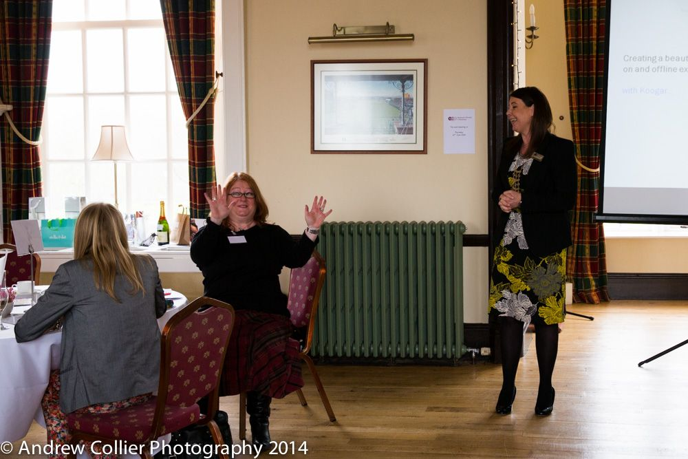 Delegates engaging in Dawn's presentation at the event.
