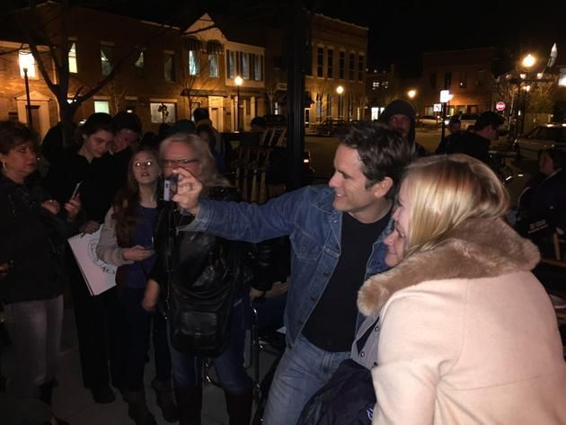 Chip Esten taking pics with fans. From Nashville