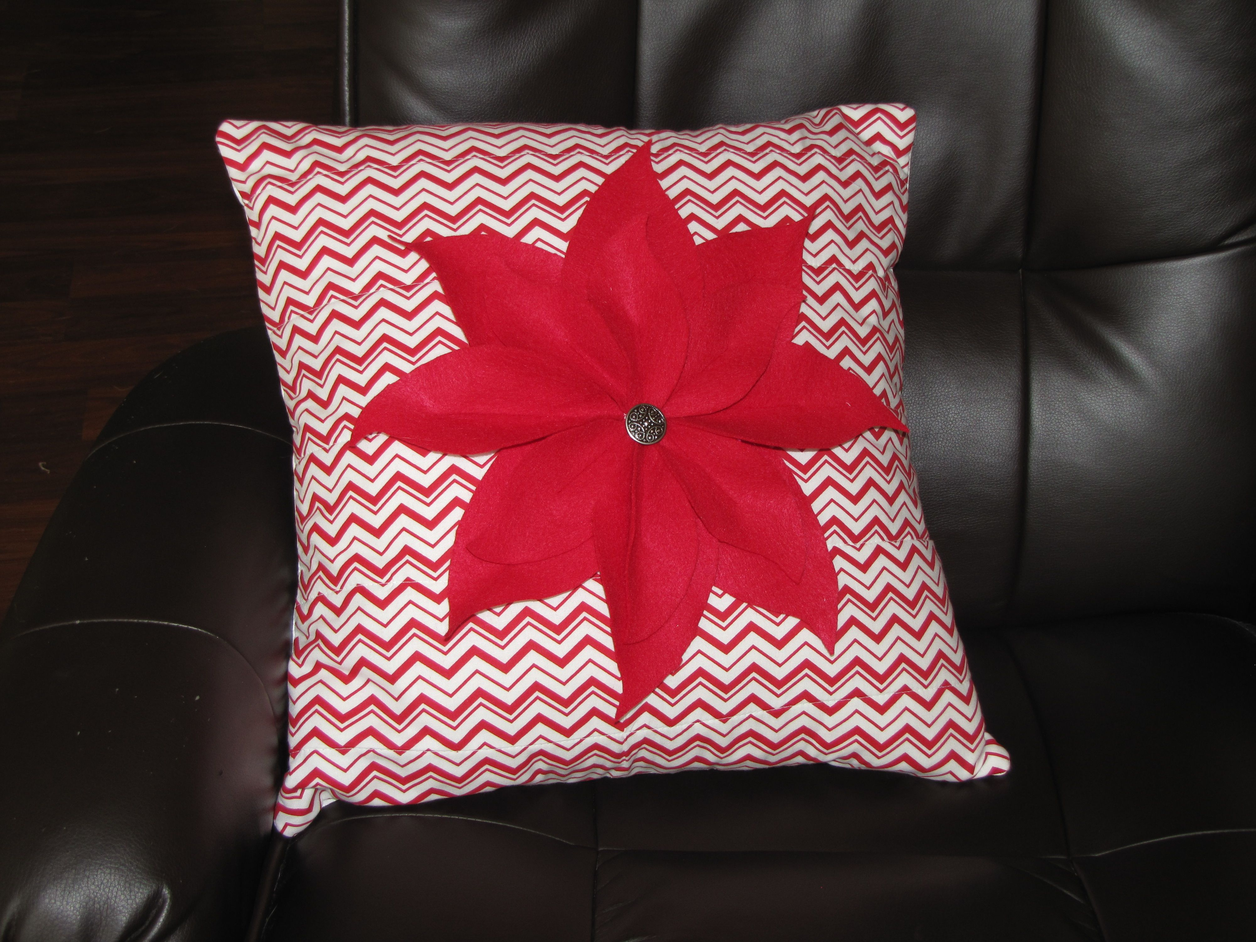 Poinsettia pillow. Flower made from felt, sewn on quilter\'s material ...