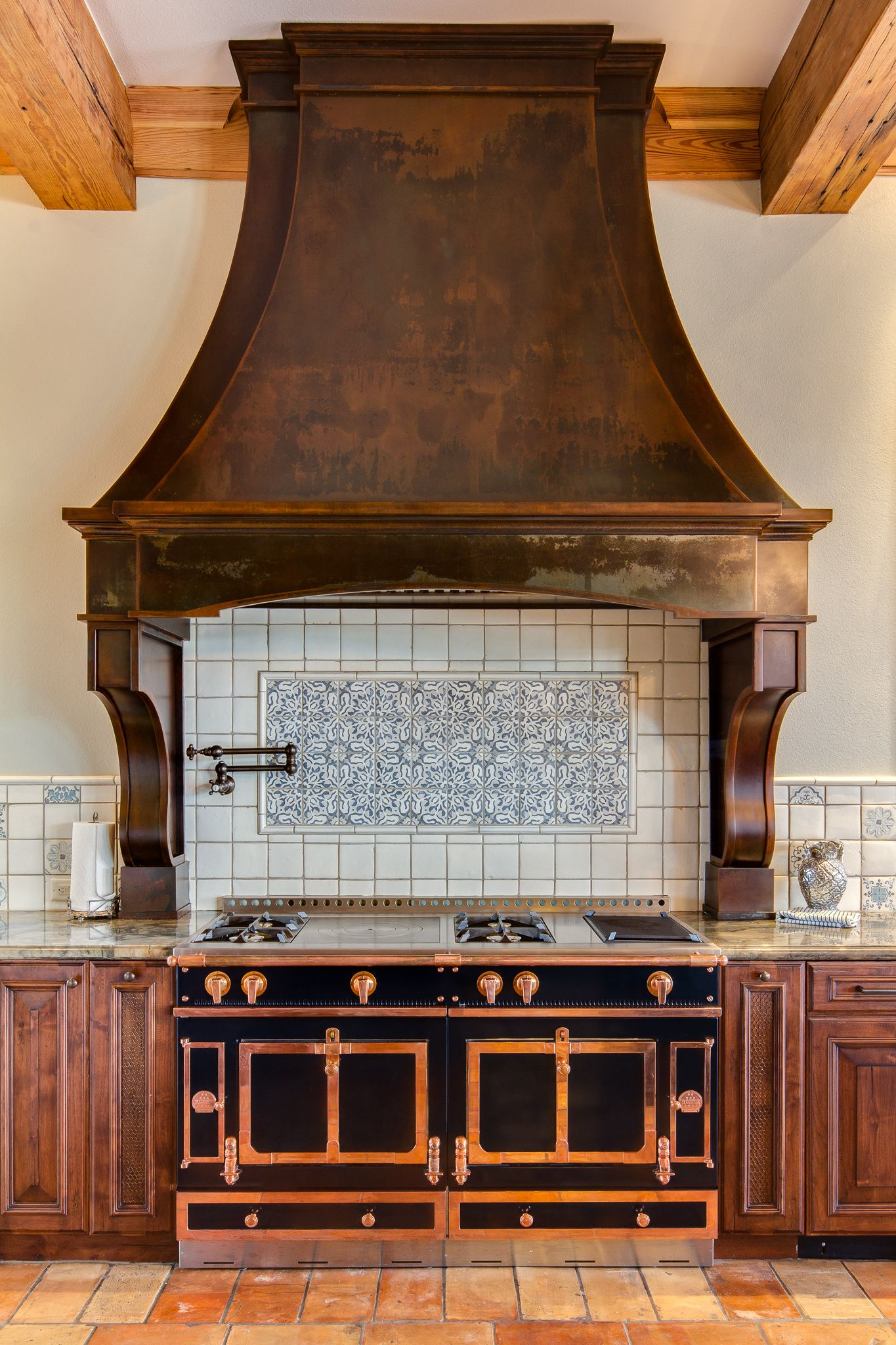 Stand out custom Cherry Hills range hood in Rustic Iron ...