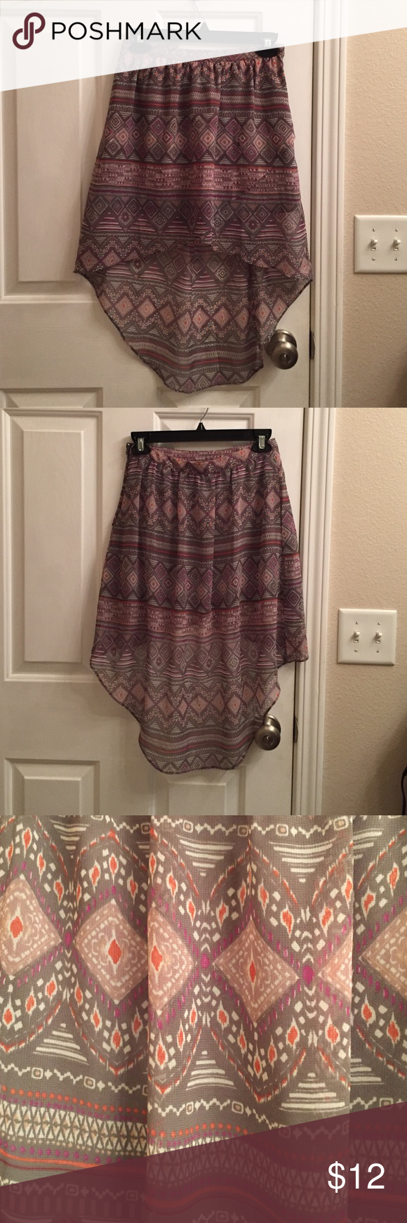 NWT 00 AE chiffon High Low skirt Nothing!!!! More romantic than a delicate printed hi-low skirt in muted greys and soft pinks/mauves/corals. This is a 00 skirt by American Eagle with the tag still attached. Perfect to romp around in this summer :) American Eagle Outfitters Skirts High Low