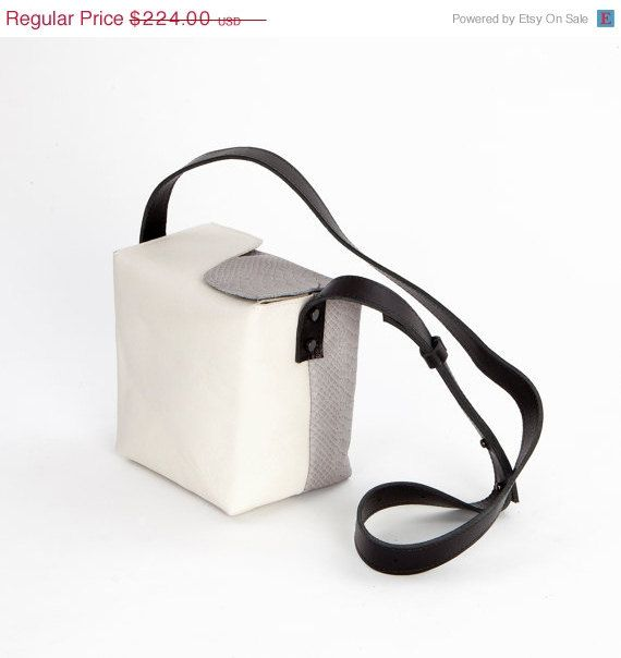 Bag name: LUNCH_BOX_GREY      A box shaped bag, will turn heads.     Size: Height: 7 inch (18 cm)  Width: 7 inch (18cm)  Depth: 5 inch (13cm)