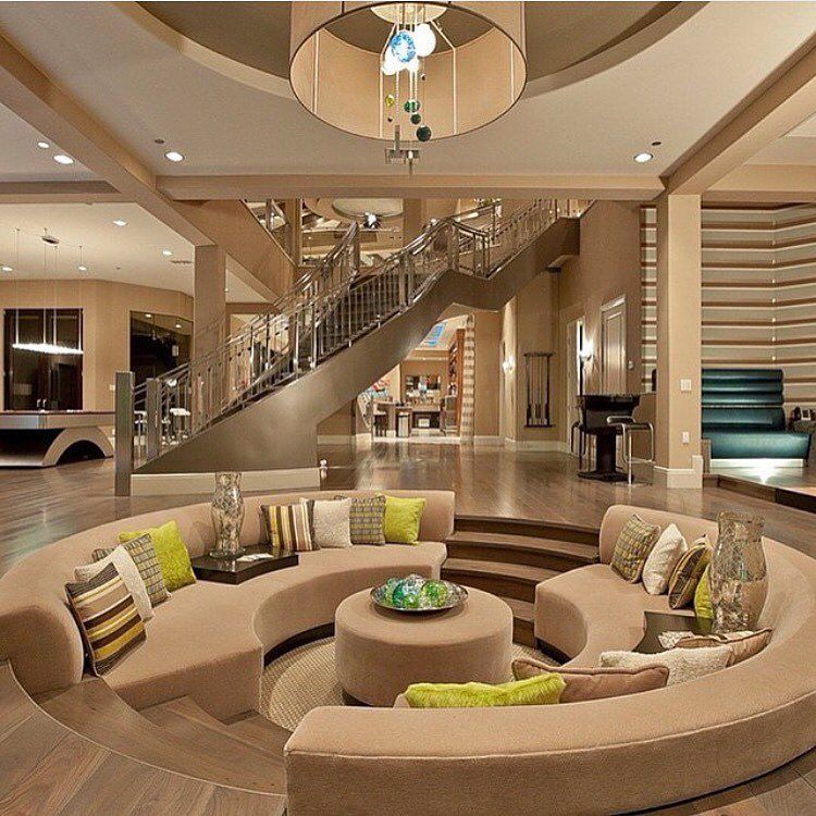 Beautiful modern mansion interior beige tan brown and green color scheme sunken living room - Home interiors living room ...