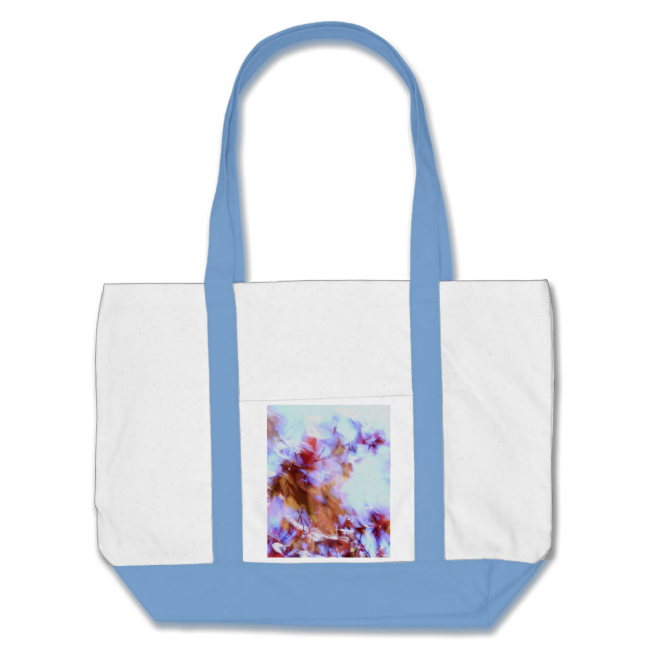 Blustery Autumn/Fall tote bag. The picture is of autumn leaves swishing in the cold north wind.