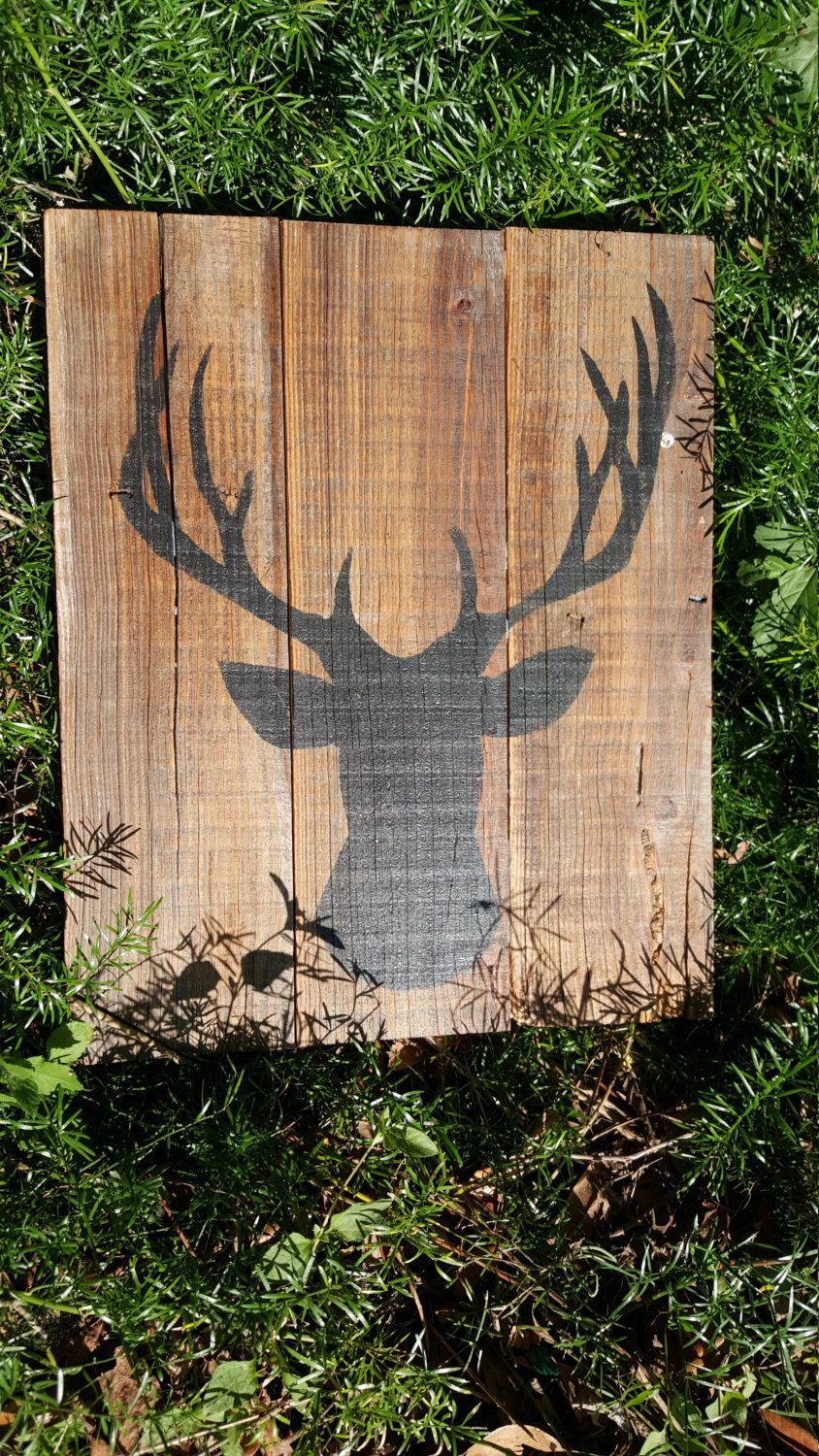 Wood sign - Deer silhouette - Deer head - Deer Hunting - Sign on rustic reclaimed barn wood. Deer silhouette on reclaimed barn wood. Measures approximately 17 tall x 14 wide and is painted in black over natural wood unless you specify otherwise. This rustic deer silhouette sign is pretty yet rustic! You can choose any basic color for the silhouette at no additional charge. **Due to the nature of the reclaimed wood, each sign will vary slightly. We feel this only adds to the character & m...