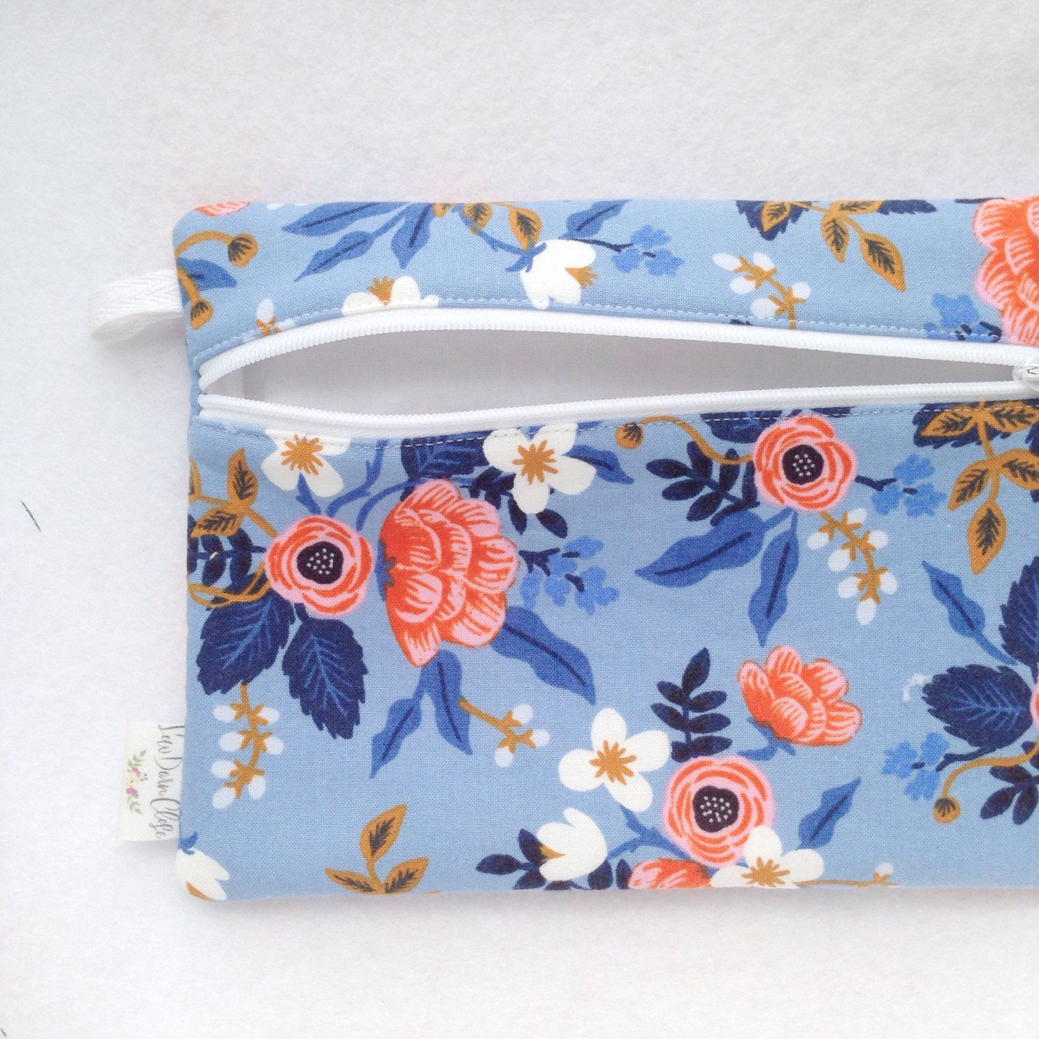 Measures approximately 8 x 6  Perfect for storing pens, pencils or other art, school, or office supplies, make up, or other small items.  Features a covered button zipper pull and small loop for grasping while unzipping or hooking onto something.  *this item is made-to-order *pattern placement may