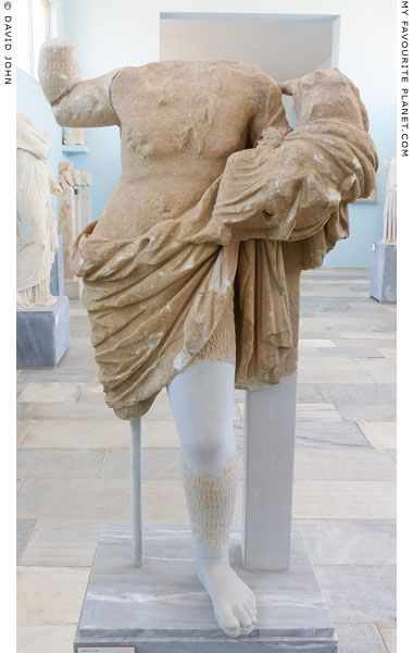 Fragmentary marble statue of an actor in the costume of Papposilenos holding the