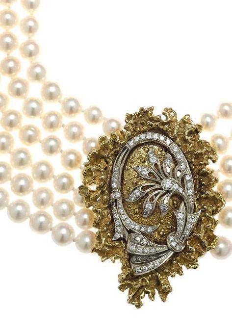 A cultured pearl and diamond multi-strand necklace