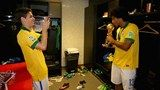 Oscar of Brazil takes a picture of Dante as he kisses the FIFA Confederations Cup trophy - FIFA.com