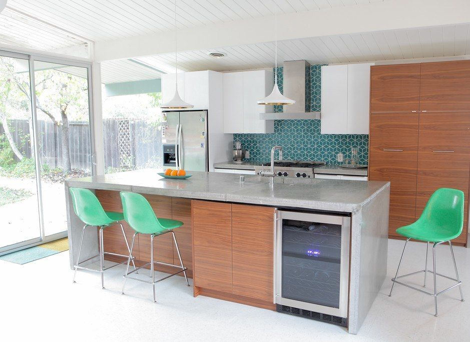 The Iconic Shape Of Eames Molded Fibergl Stool Work Well In A Mid Century Modern Kitchen