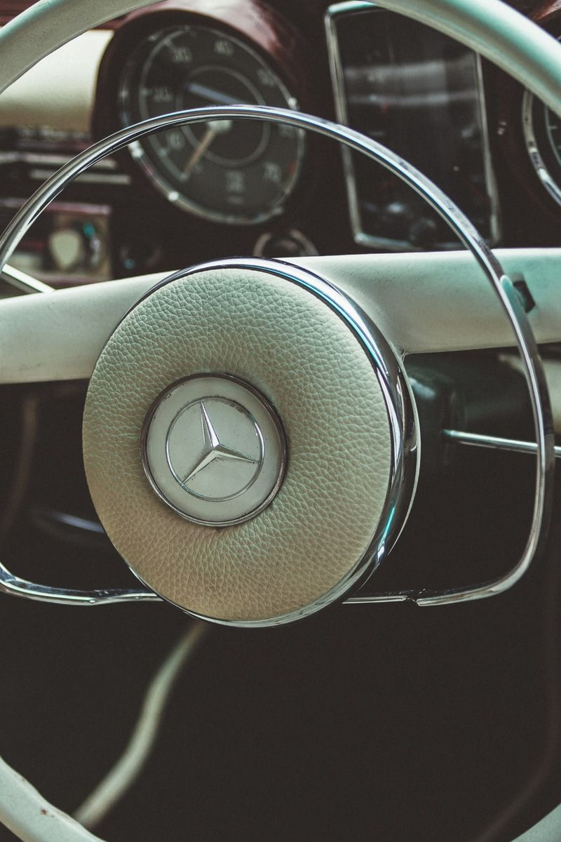 New free photo from Pexels: https://www.pexels.com/photo/vintage-white-mercedes-steering-wheel-122414 #car #vehicle #carInterior
