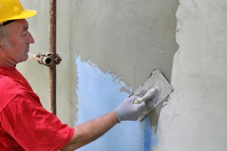 How To Apply Stucco Doityourself Com Stucco Interior Walls Diy Stucco Exterior Diy Exterior