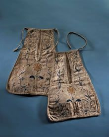 We think this pocket dates from the first half of the 18th century. Both the embroidery and making-up of the pocket are done by hand. Tie-on pockets (worn on tapes which were fastened around the waist) were common before the introduction of the handbag in the 19th century. If you look at 18th century gowns and petticoats (this was the name given to the skirt worn underneath a gown which was designed to be seen unlike today's petticoats).... - Fashion Museum - Bath (UK)