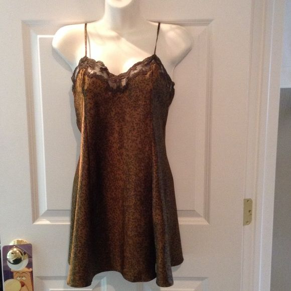 "Victoria's Secret Bronze Silky Nightgown Bronze-Gold silky nightgown with beautiful brown lace at the bust. Has adjustable straps. The length is 24"" but you can adjust that as you adjust the straps. 100% Polyester. Machine wash, tumble dry low. Victoria's Secret Accessories"