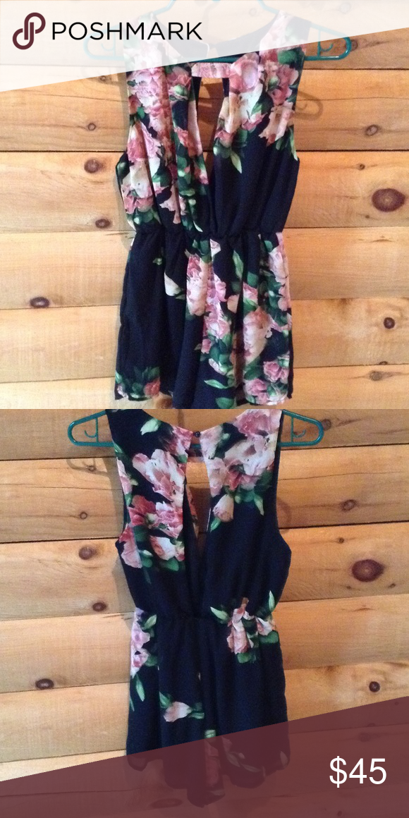 Pink Floral Blk.  Background Romper.        NWOT Pink Floral on Black Background Romper. Sleeveless V Neck Chiffon Completely Lined with easy access back zipper and button loop closure.  Deep V Back. Stretch waistline. Other