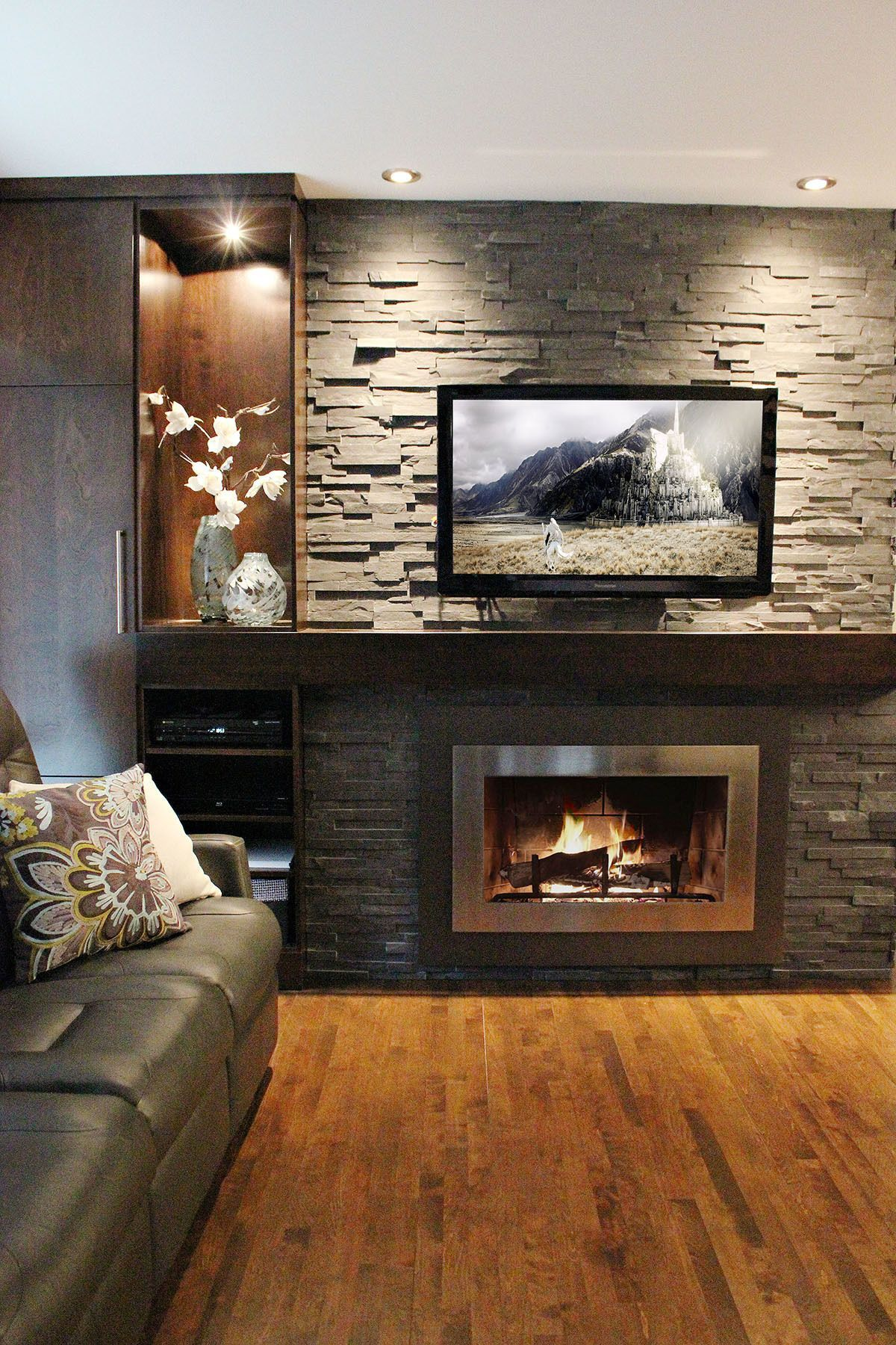 Natural Rock Fireplaces Kicking Back Simpleness A High Impressive Fireplace Is The Centerpiece Of This Ro Family Room Design Home Fireplace Room Design