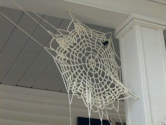 crocheted spider web halloween decor attach to an l bracket for easy installation each year