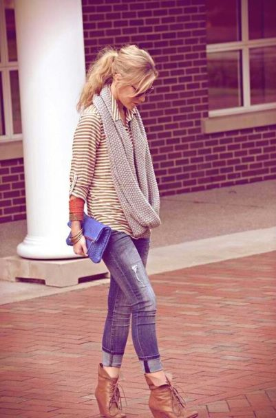 casual look: infinity scarf, striped shirt, distressed jeans, and cute booties.. ponytail and sunnies.