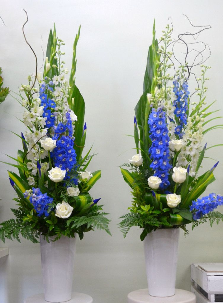 Pedestal Arranegment With White And Blue Flowers And Tropical Leaves Blue Flower Arrangements Large Flower Arrangements Large Floral Arrangements