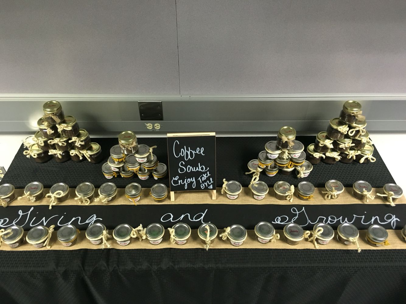 """Stubbornly Sweet Coffee and Cinnamon Scrub. These jars of """"dirt"""" were created as gifts for parents who were celebrated at a """"Giving Tree"""" themed Volunteer Appreciation lunch."""
