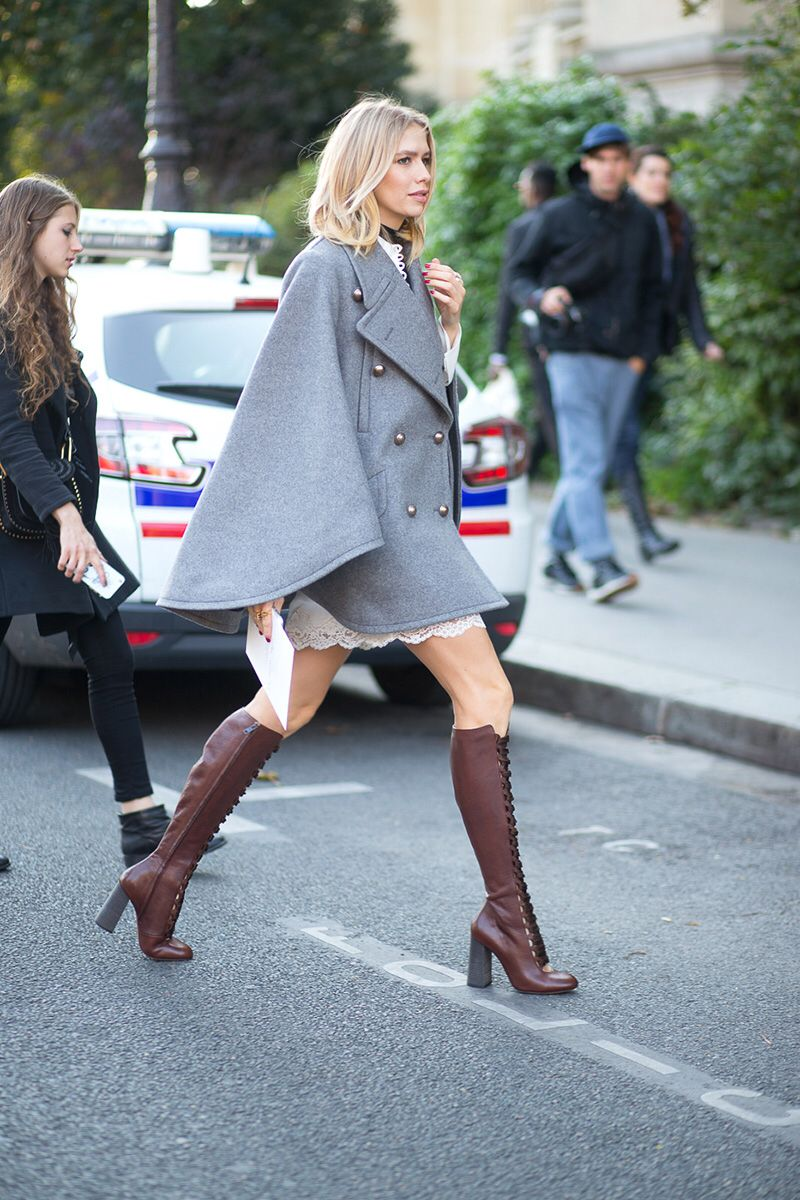 Wear a swingy cape over a similar length mini dress for a thoroughly