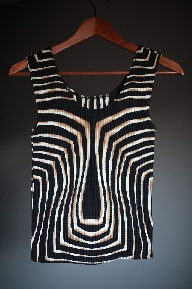 With tribal and aztec prints coming to fashion, this is quite unusual top connecting tribal, aztec, african and animal prints in one.