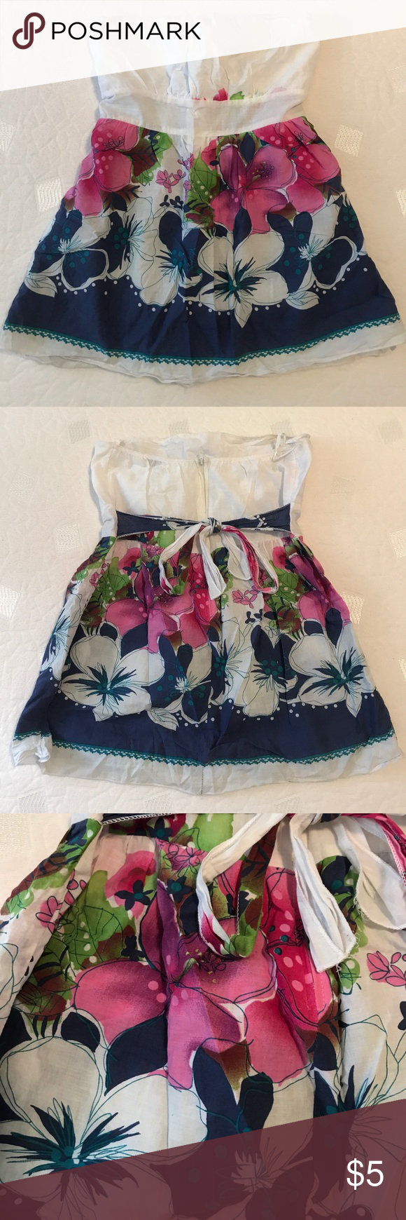Céline by Champion strapless floral top EUC fun and flirty strapless top white bust area with blue and pink floral flow away from the body bottom. Zips and ties. Céline by Champion is an L.A. Based company. Lovely top to wear on a hot summer day or at the beach. Céline by Champion Tops