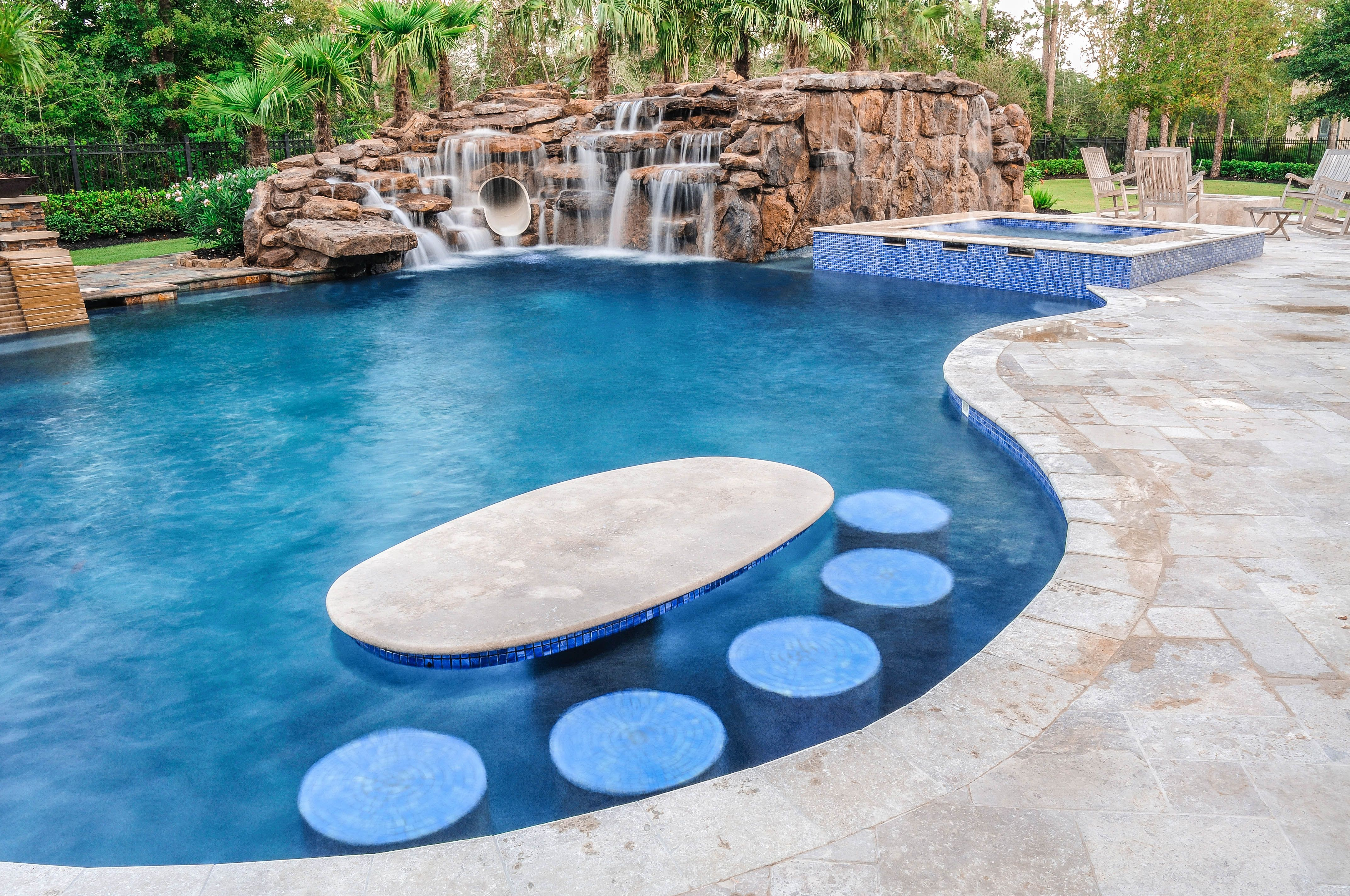 Customize The Ultimate Recreational Pool With In Pool Stools And Tables Cool Down Escape Th Swimming Pool Prices Backyard Pool Designs Swimming Pool Pictures