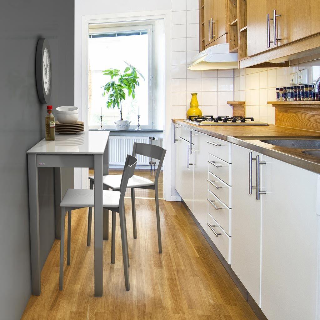 Cocina estrecha con la mesa extensible Unicca, fabricada en metal y ...