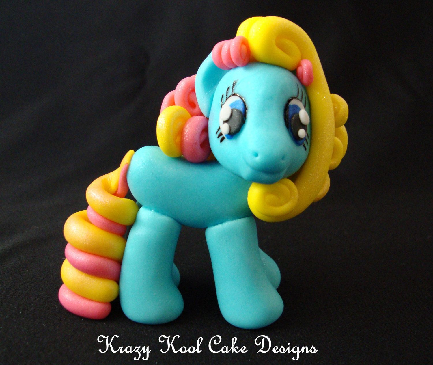 See Lovelytutorials for insturctions on how to make pony - teal/yellow/pink pony