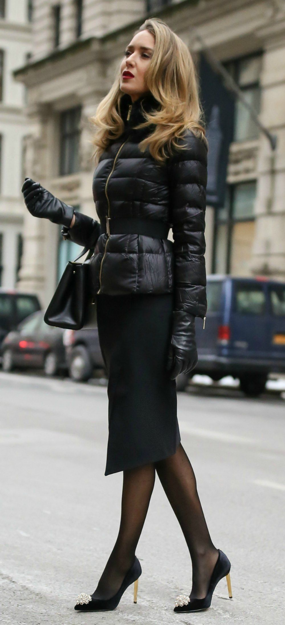 a044072e4 The Professional Puffer Coat // Black quilted puffer jacket with waist  belt, black asymmetrical pencil skirt, black embellished pumps, black sheer  tights, ...