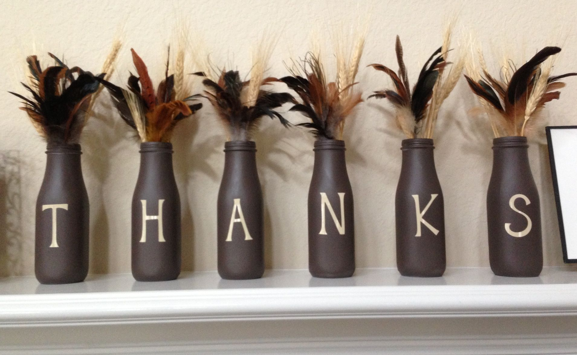 I Made These With Starbucks Bottles Brown Spray Paint And Vinyl Letters From My Circuit Starbucks Bottle Crafts Starbucks Bottles Crafts With Glass Jars
