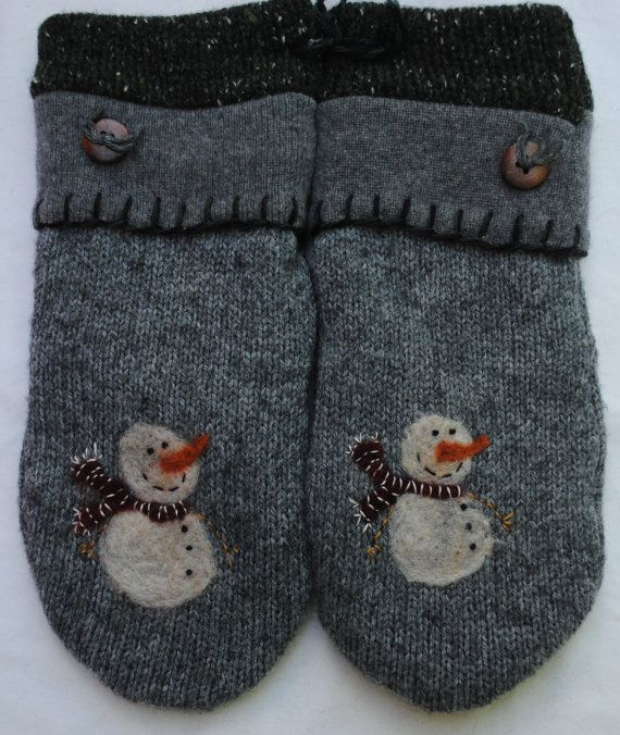 These cozy mittens are created from recycled wool sweaters. They are fully lined with warm fleece and guaranteed to keep your hands toasty. The sweater cuffs are embellished with buttons. The mittens measure about 9.5-10 inches from cuff to fingertip and are 4.5 inches across the palm. The mittens have a little felted snowman adorned with a scarf on both mittens.  For best results, please hand wash or utilize the gentle cycle and then air dry.