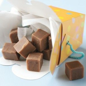 Rum and chocolate fudge squares pouring out of a paper container.