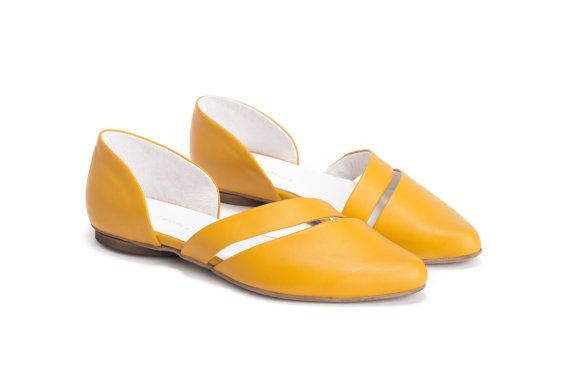 Blending an asymmetric silhouette with an eye-popping hue, these slip-ons are the perfect spring shoe. Crafted from high-quality leather and shaped with an elegant pointed toe, try them with everything from sweet sundresses to ankle-cropped jeans.  Asymmetric Pointed Toe Slip-Ons by Olive Thomas - Pointed Toe - 0.8 cm / 0.3 rubber tap - Leather upper / Leather insole & lining - Synthetic sole - Colour- Yellow - Fits true to size  * The price shown include discount. The original price was…
