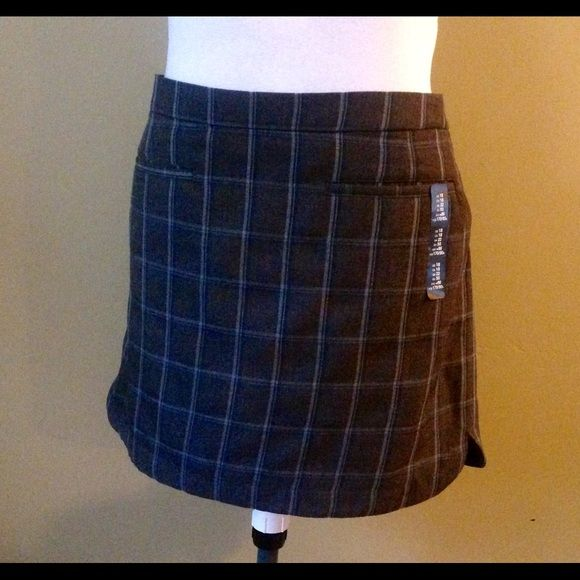 GRAY AND NAVY PLAID SKIRT Banded waist. Hidden side zip closure. Fully lined. Sits at waist. Hits at mid-thigh. Straight silhouette with an easy fit. GAP Skirts Mini