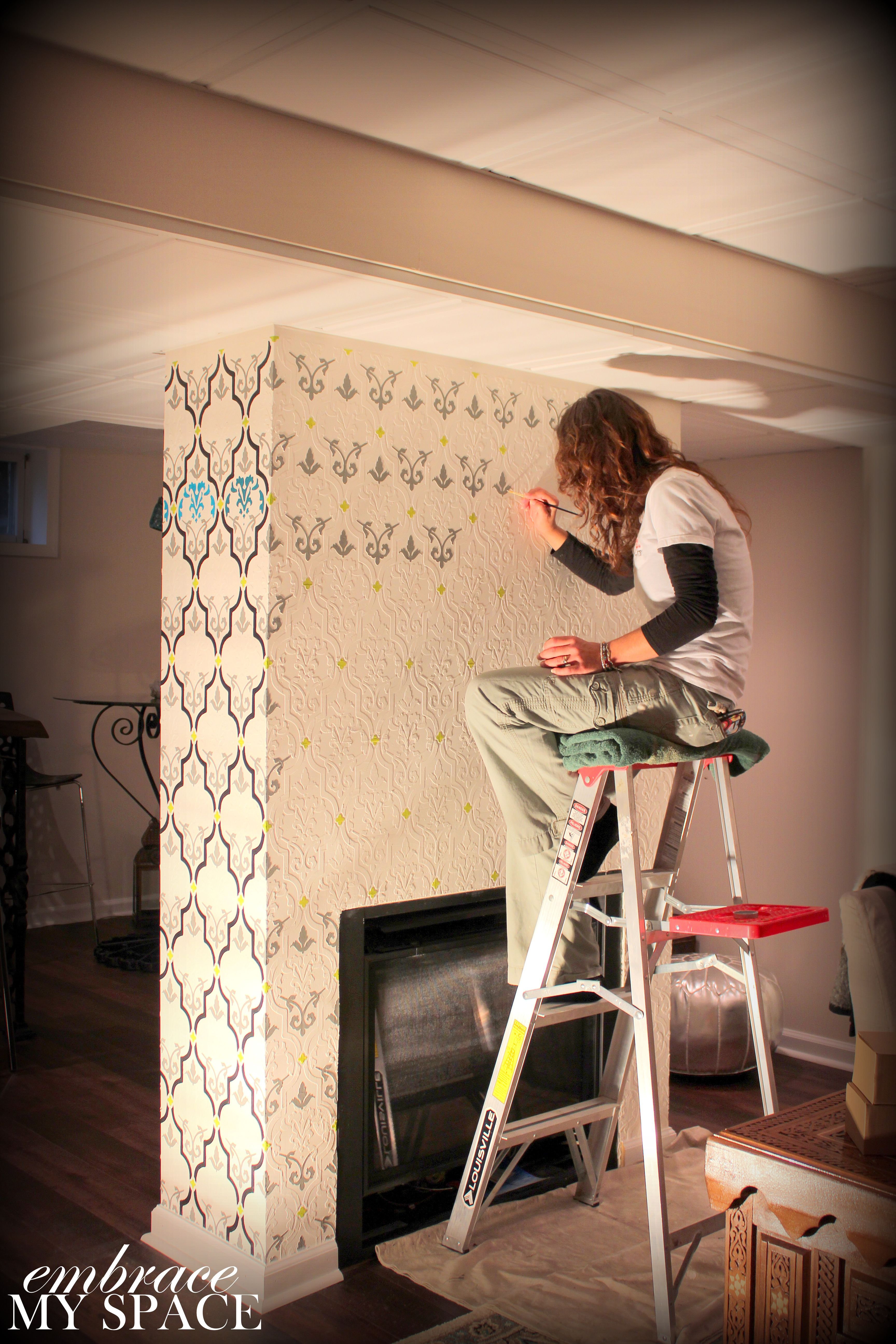 Double-sided fireplace in basement. Raised stencil then painted ...
