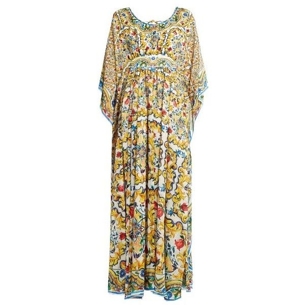 Dolce & Gabbana Majolica-print silk kaftan ($1,361) ❤ liked on Polyvore featuring tops, tunics, yellow multi, yellow silk top, ruffle top, print tunic, flutter-sleeve top and silk tops