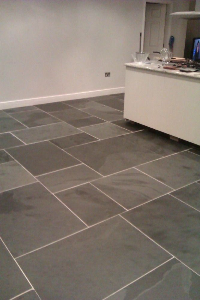 Large Rectangular Clean Slate Tiles Laid On Kitchen Floor