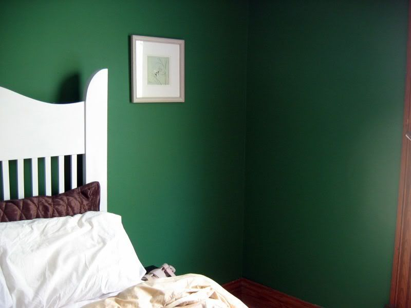 Lovely dark green walls with old-fashioned heavy dark wood trim ...