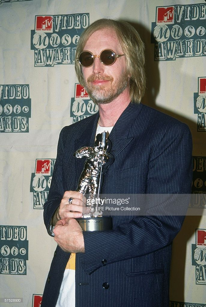 Musician Tom Petty holding MTV Video Music Award. American rock and roll musician Tom Petty poses backstage with his award trophy (a 'Moon Man') for Best Male Video (for the song 'Mary Jane's Last Dance') at Radio City Music Hall, New York, New York, September 8, 1994.