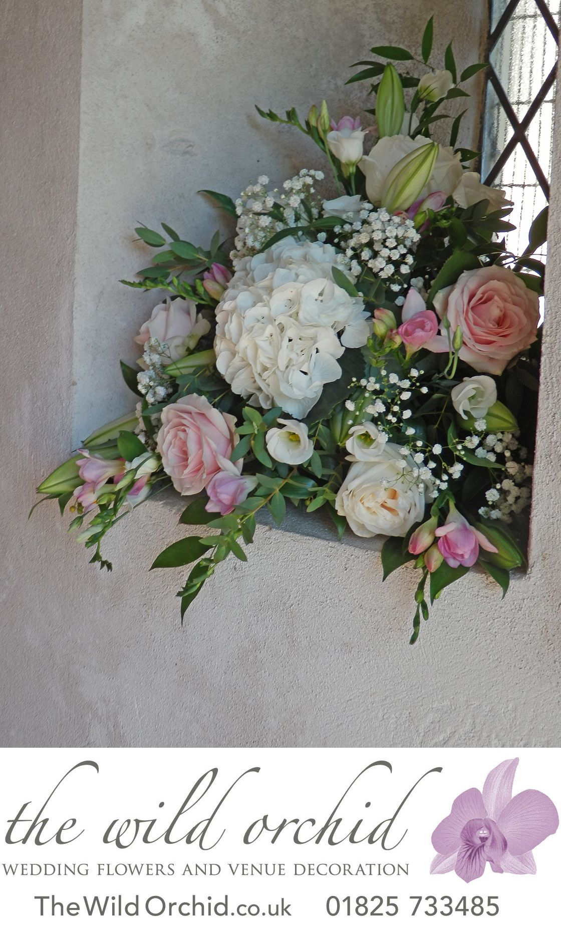 A Windowsill Arrangement In Pretty Pinks Creams And Whites Flowers