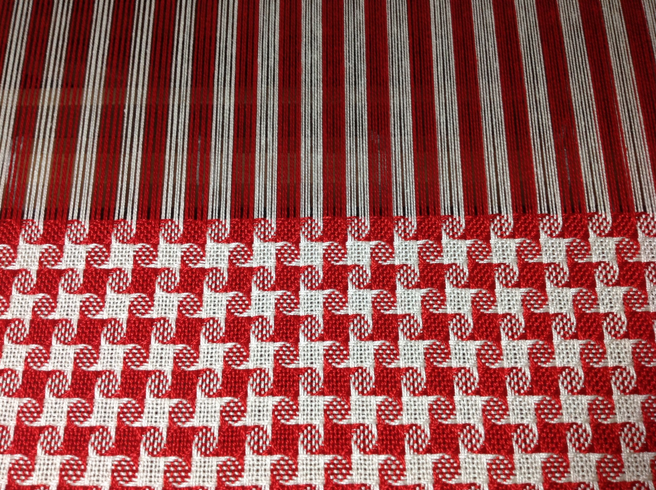This is on my loom.  Christmas placemats made with 5/2 cotton.