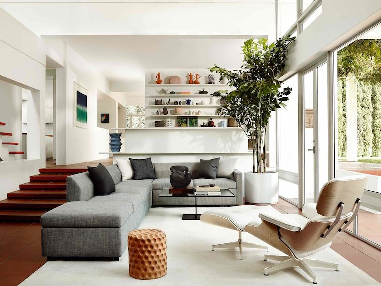 Three Quarter Rear View Of A White Leather Eames Lounge Chair And Ottoman In A Residential Lounge Chairs Living Room Eames Chair Living Room Eames Lounge Chair #white #leather #chairs #for #living #room