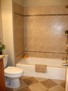 The Tile Was Applied In The Hallway Bathroom Both The Tub Bathroom Tile Designs Bathtub Tile Tile Tub Surround