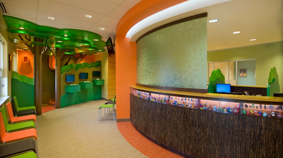 Reception Desk with little toys in view box at kids height