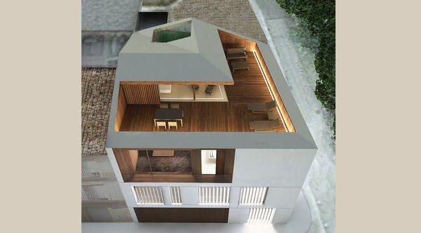 Un toit composé de deux pentes inversées renforce le dessin abstrait