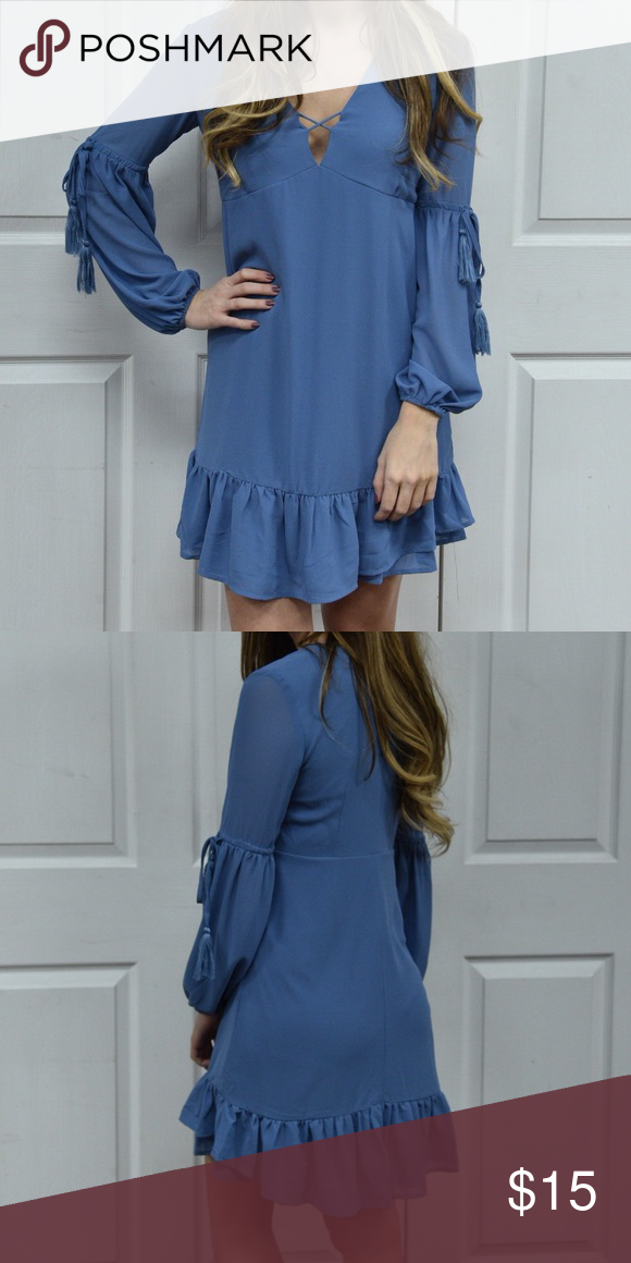 Cornflower Blue Long Sleeve Dress Beautiful cornflower blue dress with long sleeves and a crisscross detail in the middle of a deep V Dresses