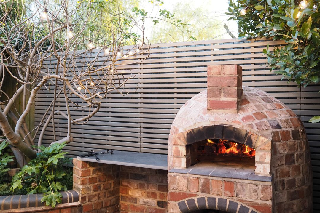 Installing a wood fired pizza oven in our garden pizza
